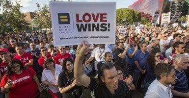 Demonstrators celebrate the U.S. Supreme Court decision legalizing same-sex marriage, in West Hollywood, Calif., on June 26, 2015. (Photo: Ringo Chiu/ZUMA Press/Newscom)