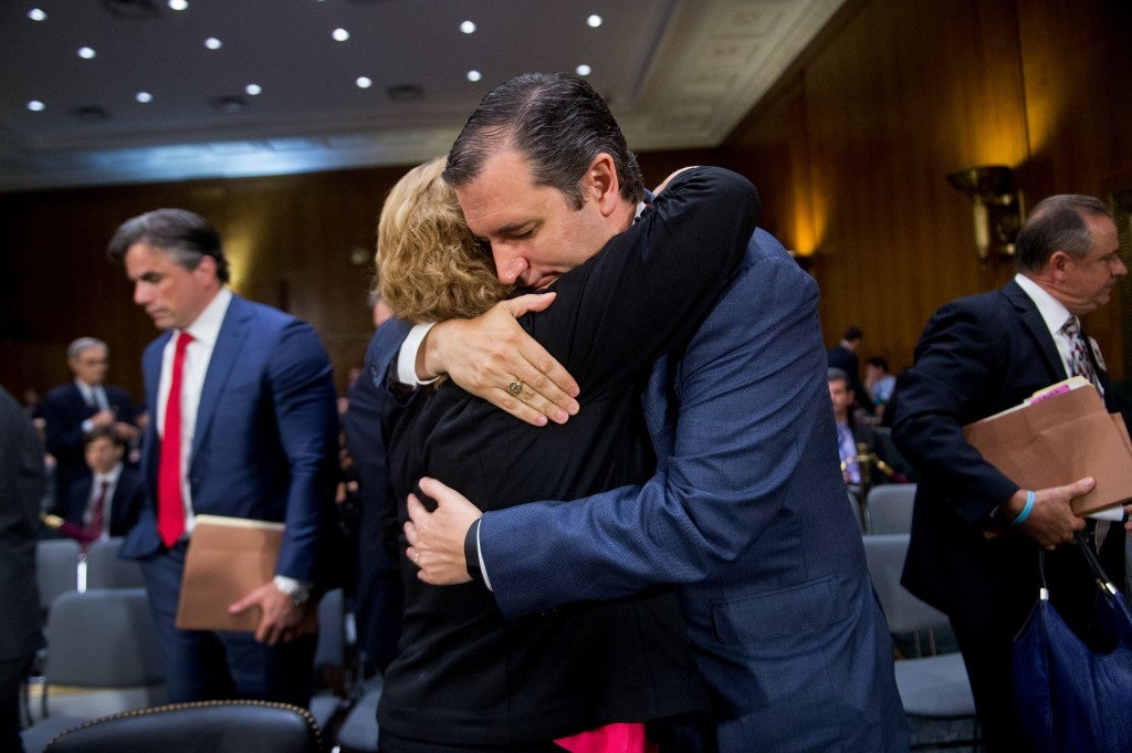 Sen. Ted Cruz, R-Texas, hugs Laura Wilkerson, whose son Josh was burned to death by his classmate who was in the U.S. illegally after offering to give him a ride home from school. Wilkerson testified during a Senate Judiciary Committee hearing July 21, 2015. (Photo: Tom Williams/CQ Roll Call/Newscom)