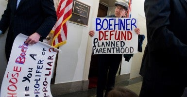 Pro-life activists protest outside the office of House Speaker John Boehner, R-Ohio. (Photo: Tom Williams/Roll Call/Newscom)
