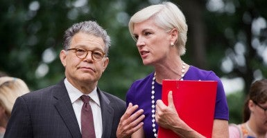 Sen. Al Franken, D-Minn., talks with Cecile Richards, president of Planned Parenthood Federation of America. (Photo: Tom Williams/CQ Roll Call/Newscom)