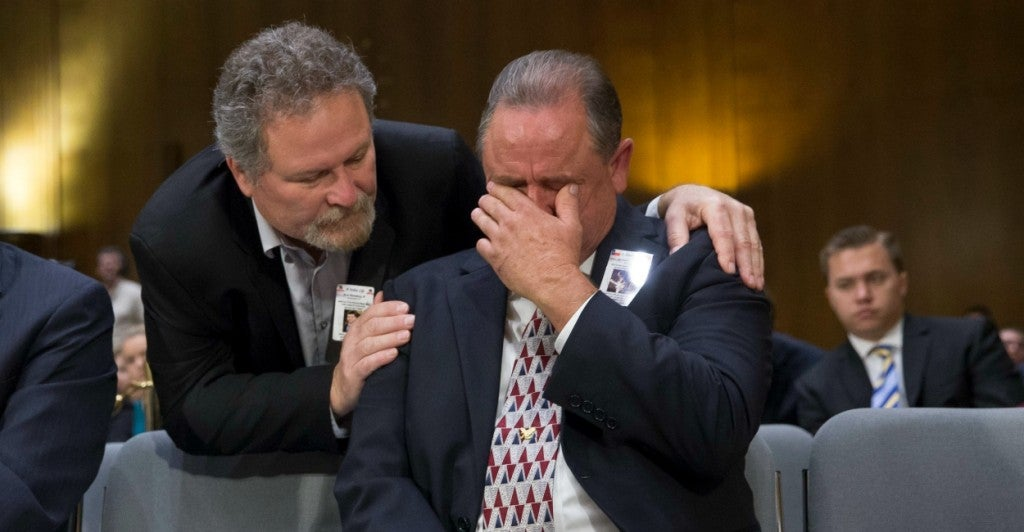 During a Senate hearing, George Wilkerson, whose son Josh was murdered by an undocumented immigrant, is comforted by Don Rosenberg, whose son Drew was killed by an unlicensed driver in the U.S. illegally. (Photo: Michael Reynolds/EPA/Newscom)