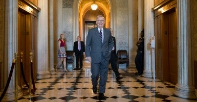 "Senate Majority Leader Mitch McConnell announced he would allow two controversial amendments to proceed as attachments to a ""must-pass"" bill to address the expiring Highway Trust Fund. (Photo: MICHAEL REYNOLDS/EPA/Newscom)"