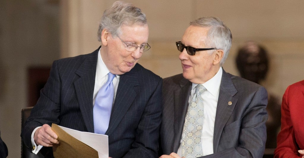 Senate Majority Leader Mitch McConnell, R-Ky., and Minority Leader Harry Reid, D-Nev., at a congressional ceremony in May. (Photo: Michael Reynolds/EPA/Newscom)