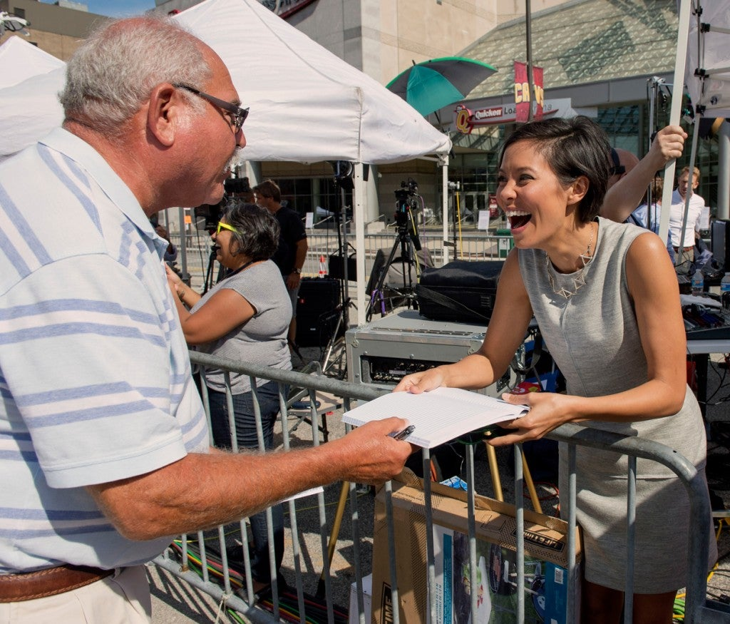 MSNBC's Alex Wagner is asked for an autograph outside the Quicken Loans Arena, site of the first 2016 Republican presidential debate. (Photo: Brian Cahn/ZUMA Press/Newscom)