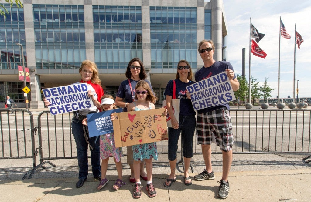 Advocates for gun control hold a protest outside the Quicken Loans Arena. (Photo: Brian Cahn/ZUMA Press/Newscom)