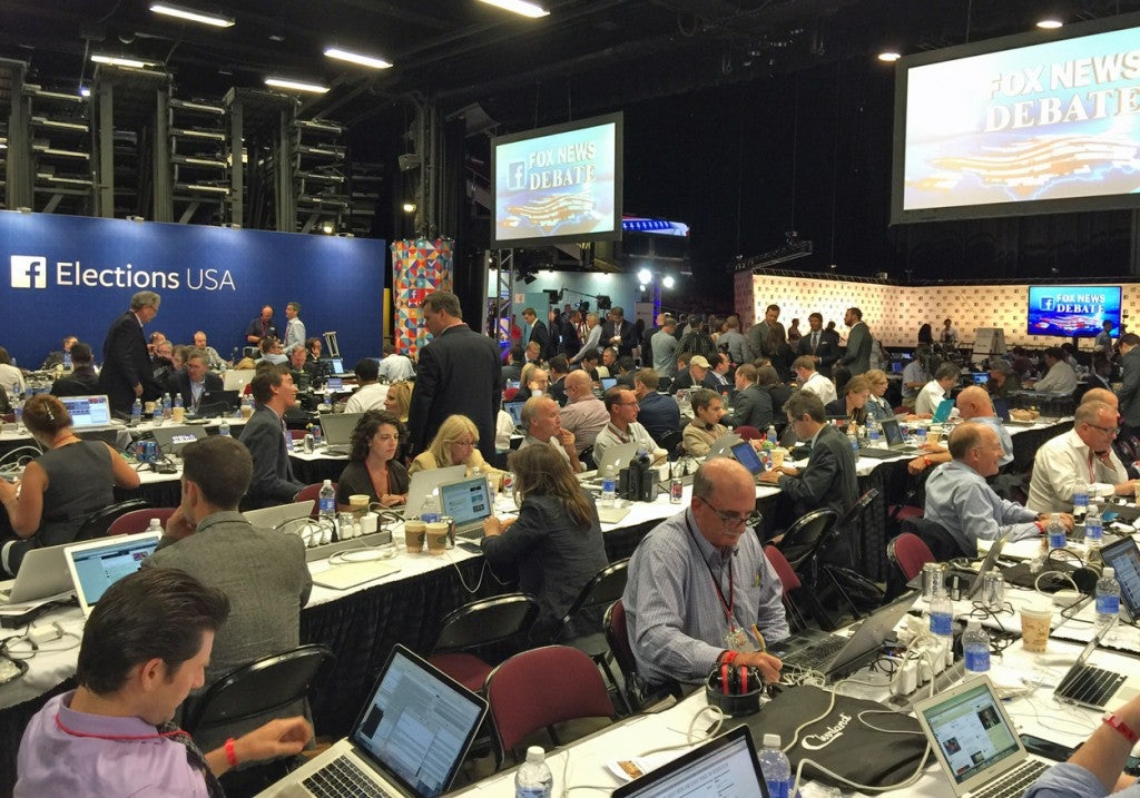 Reporters in the media filing center. (Photo: Rob Bluey/The Daily Signal)