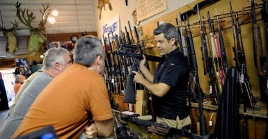 Gun store owners are threatening to sue Seattle after the City Council passed a new tax on guns and ammunition Monday. (Photo: Brian Blanco/Reuters/Newscom)