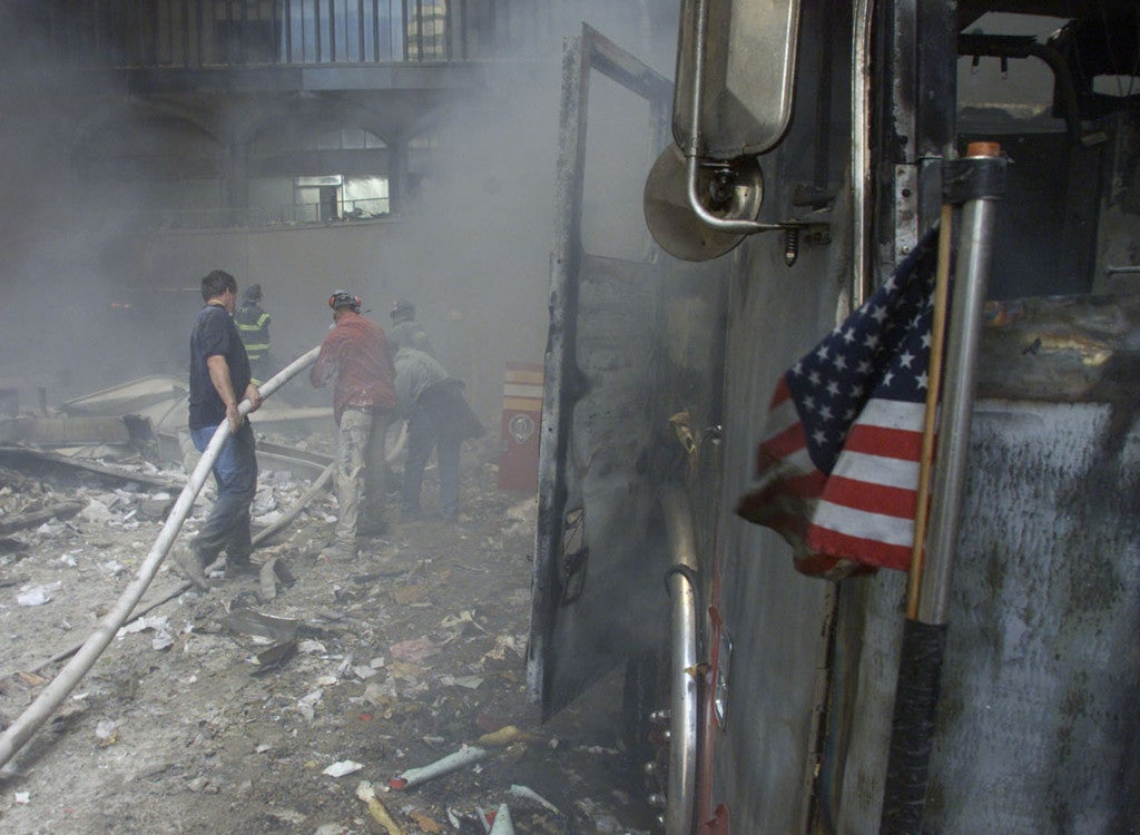 A U.S. flag flies from a burned firetruck near the wreckage. (Photo: REUTERS/Peter Morgan/Newscom)