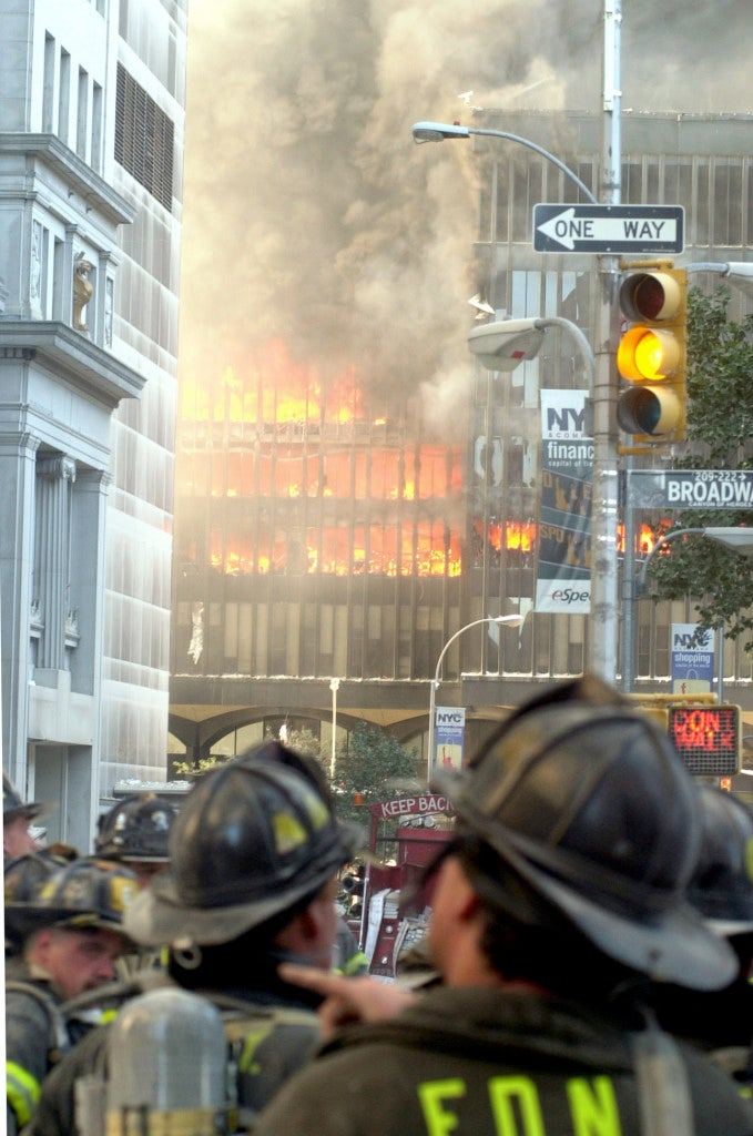 New York City firefighters stand back and watch as the remaining floors of the World Trade Center's South Tower burns uncontrollably. (Photo: Steven E. Frischling UPI Photo Service/Newscom)