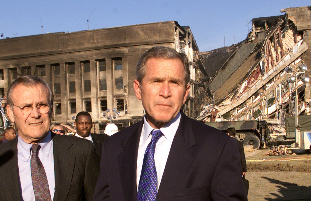 Secretary of Defense Donald Rumsfeld and President George W. Bush speak in front of the west side of the Pentagon September 12, 2001 -- the same spot where terrorists plunged an airliner earlier the day before. (Photo: REUTERS/Kevin Lamarque/Newscom)