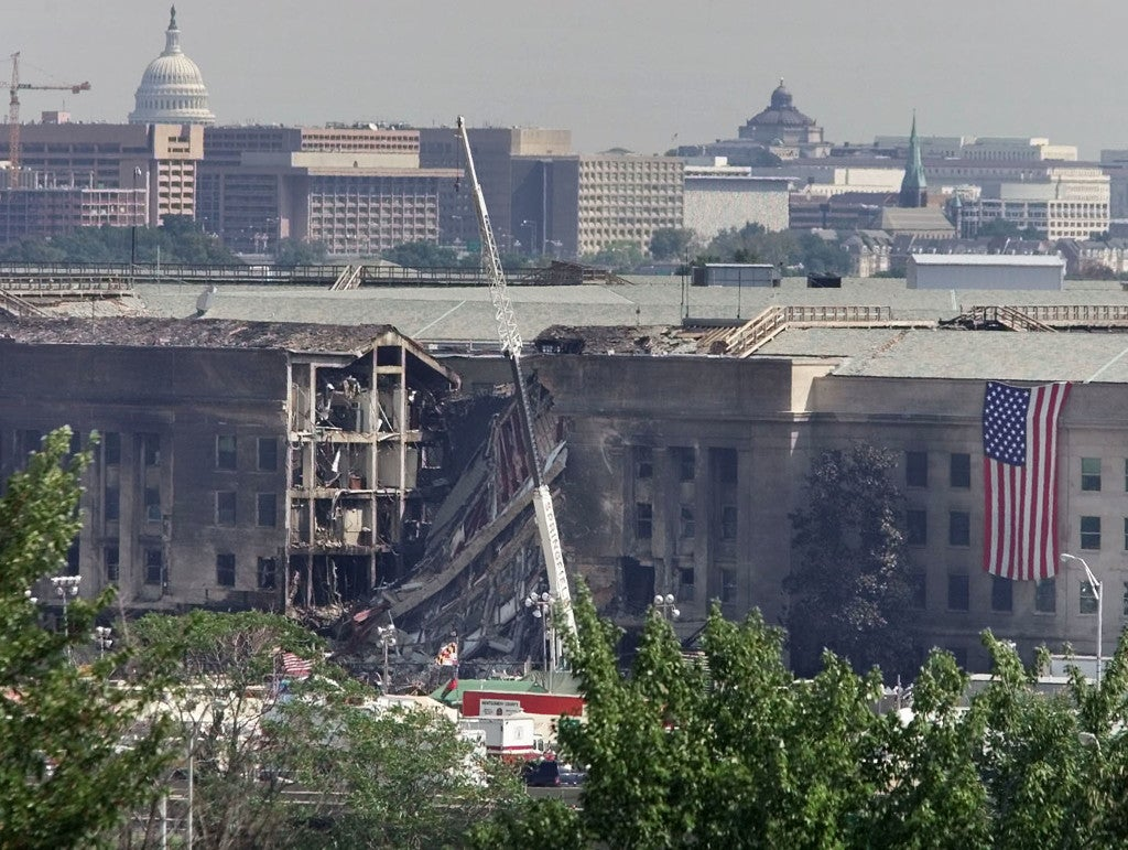 The U.S. Capitol hovers in the background over the damaged area of the Pentagon building, September 13, 2001. (Photo: REUTERS/Larry Downing/ Newscom)