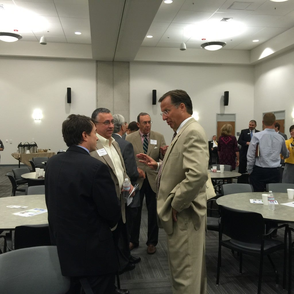 Rep. Dave Brat talks with business owners at a breakfast for the Henrico Business Council of the Greater Richmond Chamber. (Photo: Melissa Quinn/The Daily Signal)