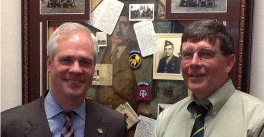 Judge Vance Day (left) with Mike Vollmar, son of a World War II paratrooper, in front of a disputed tribute to veterans at the Marion County Courthouse. (Photo courtesy Vance Day)