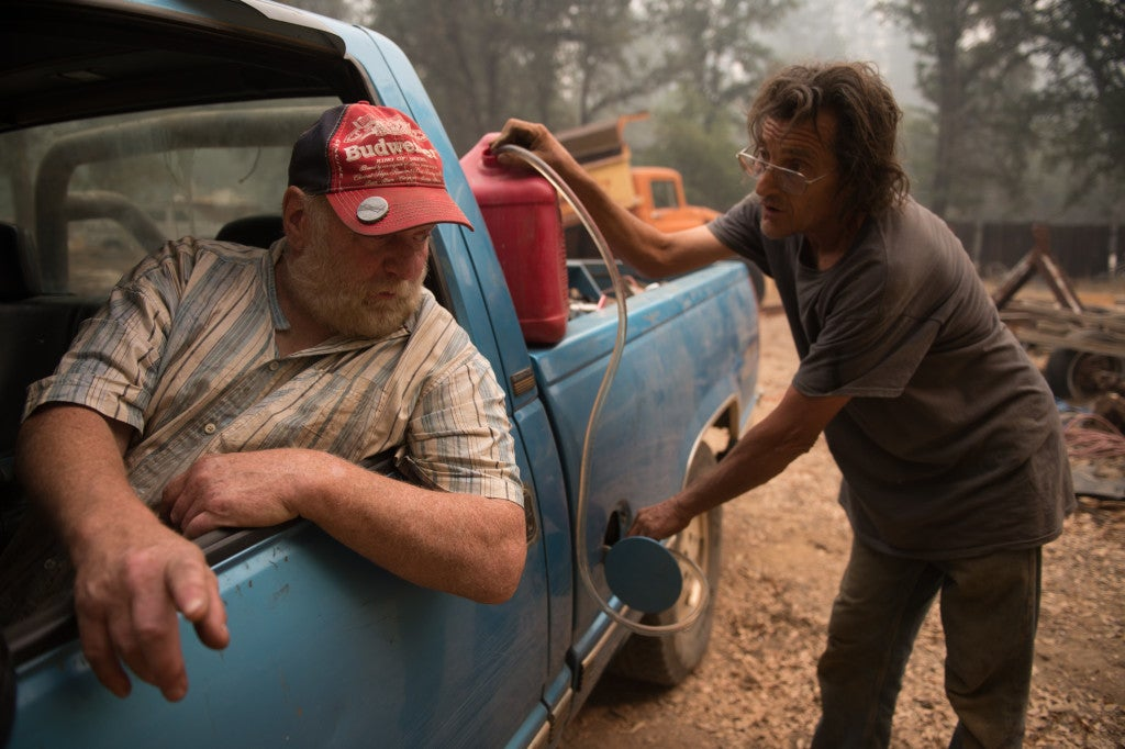 Norman Gussell  fills Steven Van Jones' tank up with gas in Jackson, Calif. Gov. Jerry Brown declared a state of emergency Friday afternoon in Calaveras  and Amador Counties as many attempt to evacuate. (Photo: Andrew Seng/Newscom)