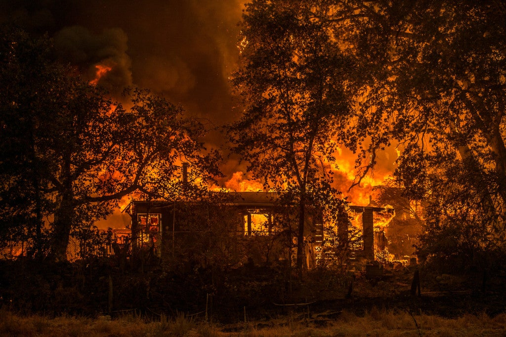By Sept. 10 after two days of destruction, the fire burned nearly 65,000 acres. (Photo:Andrew Seng/Newscom)