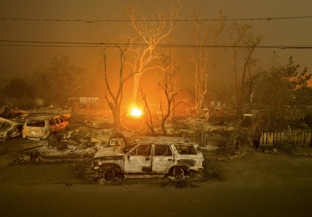 Burned out remains of vehicles and homes scorched by the Valley Fire line Wardlaw St. in Middletown, California September 13, 2015. (Photo: REUTERS/Noah Berger/Newscom)