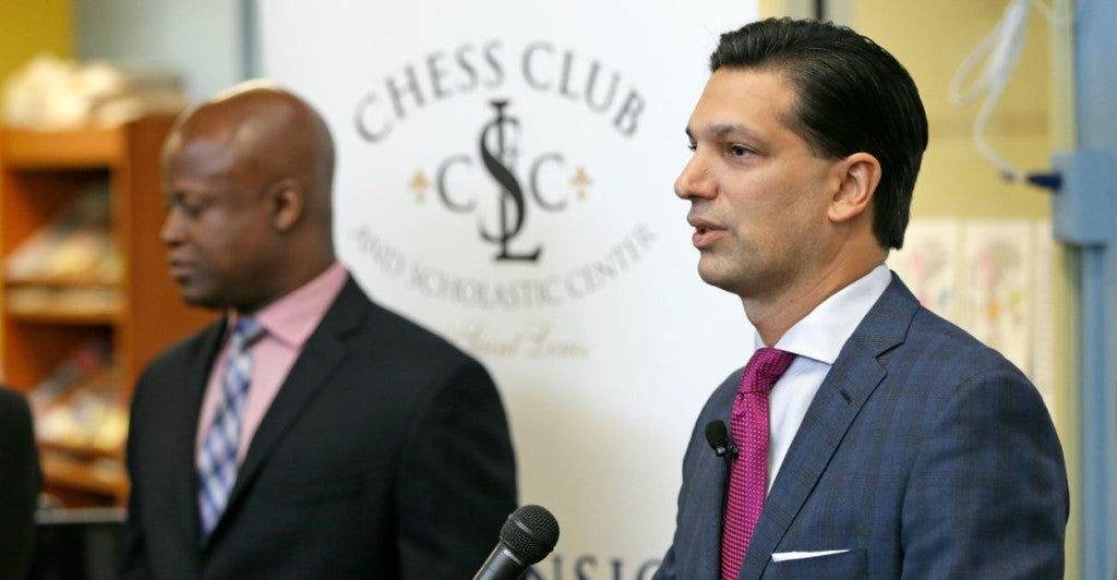 Nick Ragone (right) announces a partnership between Ascension and the Chess Club and Scholastic Center of St. Louis at Walnut Grove Elementary in Ferguson. (Photo: Ascension)