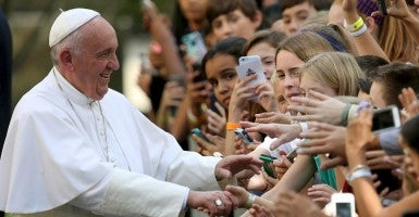 Pope Francis greets school children upon departure from the Vatican Embassy in Washington on day three of his first visit to the United States (Photo: Gray Cameron/Reuters/Newscom)