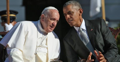 President Barack Obama confers with Pope Francis during the pope's arrival ceremony at the White House. (Photo: Win McNamee/UPI/Newscom)