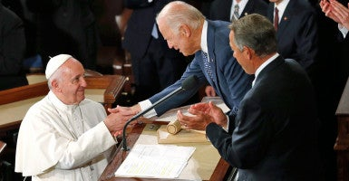 Pope Francis is greeted by Vice President Joe Biden in the House chamber prior to addressing a joint meeting of Congress. (Photo: Jonathan Ernst/Reuters/Newscom)