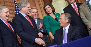 Speaker John Boehner shakes Sen. John Hoeven's hand after signing his bill to to approve the Keystone XL pipeline project. (Photo: Caleb Smith/Flickr/CC BY-NC 2.0)