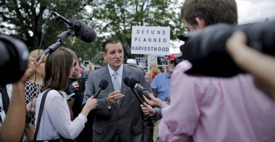 Sen. Ted Cruz, R-Texas, talks to reporters before speaking at a rally to end federal funding for Planned Parenthood in Washington, D.C. (Photo: Carlos Barria/Reuters/Newscom)