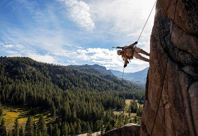 Lance Cpl. Julio C. Miranda Jr. rappels down a cliff during Mountain Exercise 2014, aboard Marine Corps Mountain Warfare Training Center in Bridgeport, Calif. (Photo: Sgt. Emmanuel Ramos/Released)