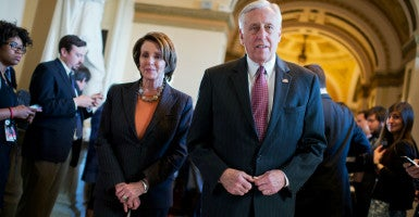 House Democrats, led by Minority Leader Nancy Pelosi of California and Minority Whip Steny Hoyer of Maryland, signed onto a discharge petition that would force a vote on reauthorization of the Export-Import Bank. With support from more than 50 Republicans, the petition received the 218 signatures it needed to be considered on the House floor. (Photo: Tom Williams/CQ Roll Call/Newscom)