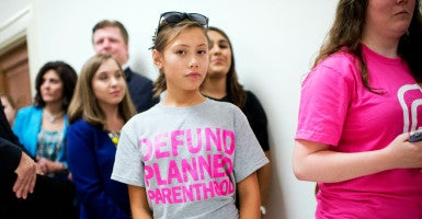 Xotchil Flores, 12, waits to enter a House Oversight and Government Reform Committee hearing on Planned Parenthood. (Photo: Tom Williams/CQ Roll Call/Newscom)
