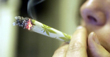 "A new bill would allow states that are ""effectively"" regulating marijuana to bypass the federal Controlled Substances Act, which still bars the drug's use. (Photo: Elio Colavolpe/Ropi/ZUMA Press/Newscom)"