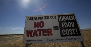A sign referencing the drought is posted on the side of the road in Mendota, Calif. (Photo: Ringo Chiu/ZUMA Press/Newscom)