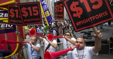 People celebrate the passage of the minimum wage for fast-food workers by the New York State Fast Food Wage Board during a rally in New York on July 22. The National Restaurant Association filed a petition last week in an attempt to get the wage increase scrapped. (Photo: Brendan McDermid/Reuters/Newscom)