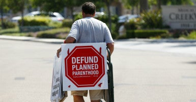 A protester leaves after demonstrating outside a Planned Parenthood clinic in Vista, California, Aug. 3. (Photo: Mike Blake/Reuters/Newscom)