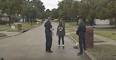 Two police officers question Dorothy Bland in her Corinth, Texas, neighborhood on Oct. 24. (Photo: Corinth Police Department)