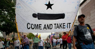 Tea party activists participate in a 2010 march along Pennsylvania Avenue in Washington, D.C., many proclaiming  their right to bear arms. (Photo: Jeff Malet Photography/Newscom)