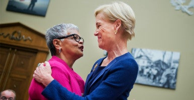 Rep. Bonnie Watson Coleman, D-N.J. (left), greets, Cecile Richards, president of Planned Parenthood Federation of America, before a House Oversight and Government Reform Committee hearing on whether PPFA should be federally funded Sept. 29. (Photo: Tom Williams/CQ Roll Call/Newscom)