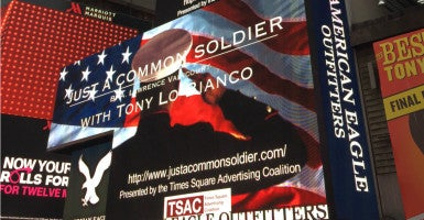 "Veterans gathered in Times Square to watch a video tribute that featured the poem ""Just a Common Soldier."" (Photo courtesy of Stephen Clouse)"