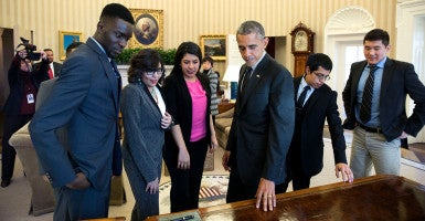 President Barack Obama shows the Resolute Desk to a group of DREAMers following their Oval Office meeting in which they talked about the Deferred Action for Childhood Arrivals program, Feb. 4, 2015. (Photo: Pete Souza/White House)