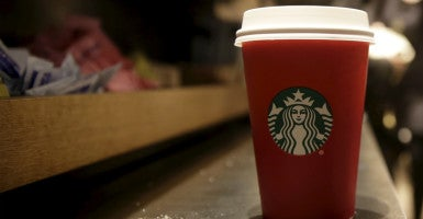 Some contend  Starbucks' new red cup for the holidays isn't Christmassy enough.  Get over it, others advise. (Photo: Brendan McDermid/Reuters/Newscom)
