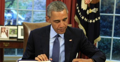President Barack Obama signs the  budget bill Nov. 2. It raises the debt ceiling and lifts spending limits. (Photo: Dennis Brack/UPI/Newscom)