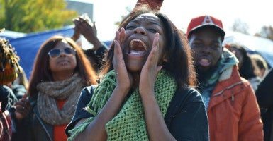 A student chants after the University of Missouri's president, Tim Wolfe, stepped down Nov. 9. (Photo: Alexzandria Churchill/Reuters/Newscom)