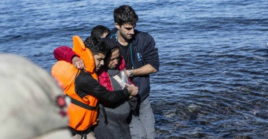 Syrian refugees arrive in Greece after traveling across the Aegean Sea. Once they make landfall in Greece, employees with Samaritan's Purse and other groups meet them and provide refugees with food, water and blankets. (Photo: Depo Photos/ZUMA Press/Newscom)