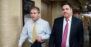 Reps. Jim Jordan, R-Ohio, and Raúl Labrador, R-Idaho, said they expect to see policy riders addressing Syrian refugees and pro-life issues included in the $1.1 trillion omnibus spending package. However, the House Freedom Caucus, of which they are members of, will oppose a campaign finance measure floated by Senate Majority Leader Mitch McConnell and another funding Obamacare's risk corridor program. (Photo: Bill Clark/CQ Roll Call/Newscom).