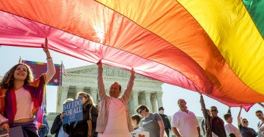 Advocates on both sides of the marriage debate rally at the U.S. Supreme Court before its ruling asserting a right to same-sex marriage.  (Photo: Pete Marovich/Newscom)