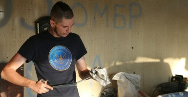 In a pro-America style choice, a Ukrainian soldier on the front line wears a T-shirt from the Ronald Reagan Presidential Library. (Photo: Nolan Peterson/The Daily Signal)