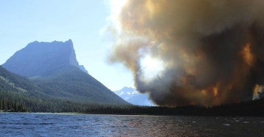 A wildfire sweeps through 4,000 acres in  Glacier National Park, Montana, in July. Federal officials restricted use of state helicopters to fight the fire.  (Photo: Erin Conwell/ Reuters/ Newscom)