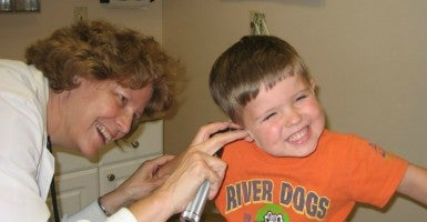 Dr. Alieta Eck visits with a patient at the Zarephath Health Center. (Photo: Courtesy of Dr. Alieta Eck)