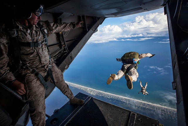 Force Reconnaissance Marines with the Maritime Raid Force, 24th Marine Expeditionary Unit perform a diving exit while conducting an initial High Altitude Low Opening jump out of a MV-22B Osprey. (Photo: Cpl. Todd F. Michalek/ Released)
