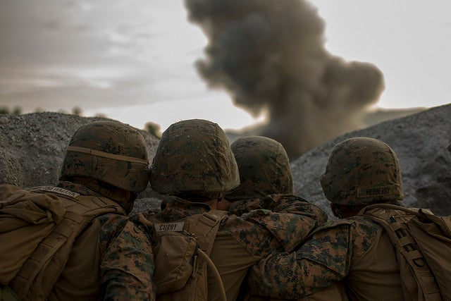 U.S. Marines observe explosives detonate from a safe distance on a demolitions range at Crow Valley, the Philippines. (Photo: Staff Sgt. Joseph DiGirolamo/Released)