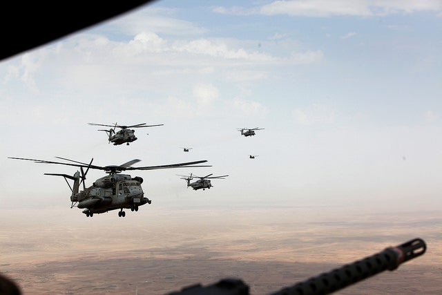 Marine Corps and Royal Air Force helicopters fly in formation after departing Camp Bastion, Afghanistan. (Photo: Staff Sgt. John Jackson/Released)